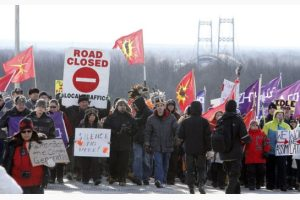 First Nations Idle No More protestors march and block the International Bridge between the Canada and U.S. border near Cornwall Ontario