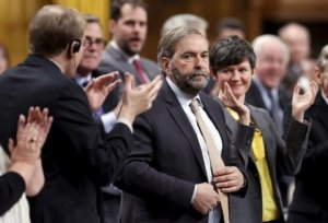 new-democratic-party-leader-thomas-mulcair-c-receives-a-standing-ovation-from-his-caucus-during-question-period-in-the-house-of-commons-on-parliament-hill-in-ottawa-april-22-2015-reuterschris-wattie
