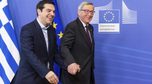 European Commission President Jean-Claude Juncker, right, walks hand in hand with Greece's Prime Minister Alexis Tsipras upon his arrival at the European Commission headquarters in Brussels to meet with EU leaders. (Source: AP)