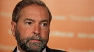 NDP Leader Tom Mulcair talks to the press at the NDP's annual summer caucus retreat in St. John's, N.L., on Wednesday, September 5, 2012. THE CANADIAN PRESS/Paul Daly